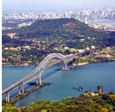 View of modern day Panama City and Puente de las Americas Bridge at the entrance of the Panama Canal on the Pacific side
